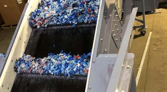 Textile waste being processed for recycling via carbon renewal technology.