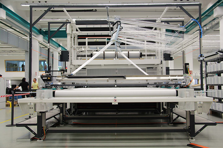 Karl Mayer's integrated spreading and impregnation unit for carbon fibers