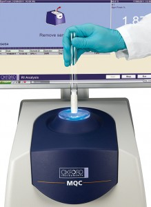Oxford Instruments' Benchtop NMR analyzer processing a sample from production.