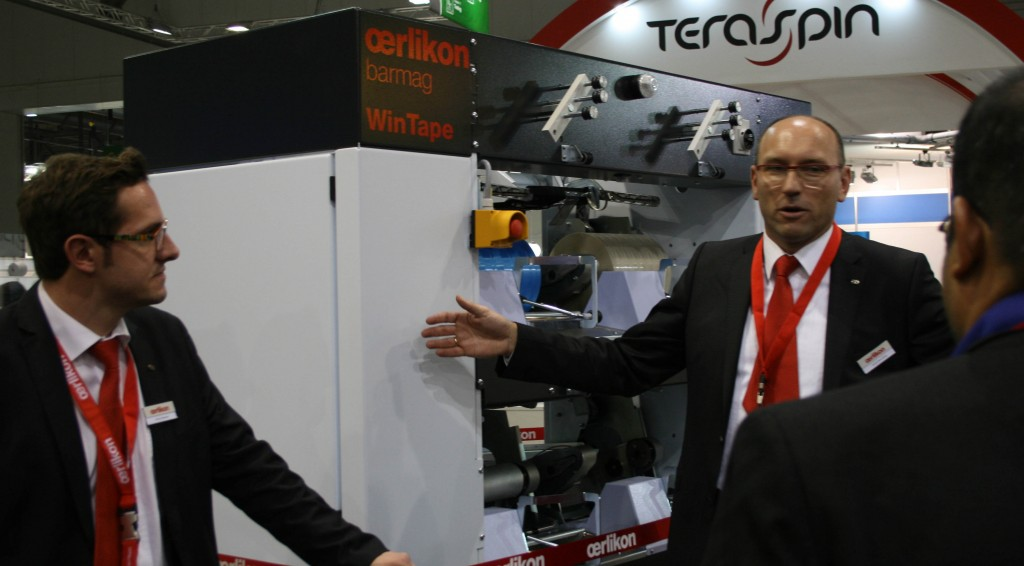 Oerlikon's head of marketing André Wissenberg explains machine features at the company's stand.