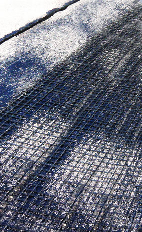 Geogrids made from industrial yarn often serve as reinforcement for asphalt.