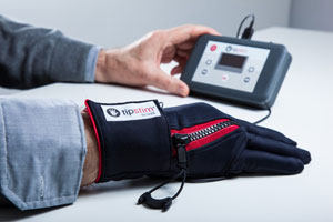 Tipstim glove: Tipstim is a novel textile-based product for the treatment of stroke patients: the patient puts the sensor glove on, connects it to the pulse transmitter and starts the therapy on their own without the need of medical attendance. Photo: Bosana Medizintechnik
